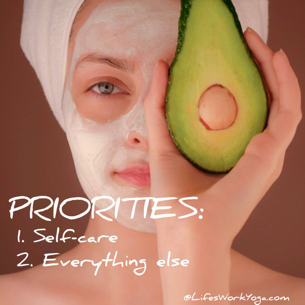 Woman holding avocado in front of face